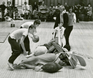 Grand Union performance to benefit te Committee to Defend the Black Panthers, 1971, L to R: Becky Arnold, Nancy Lewis, Barbara Dilley, Douglas Dunn, Yvonne Rainer; under cover: Steve paxton, David Gordon. Photo © Peter Moore
