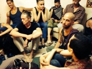 Inside shelter, Ian Robinson with hand on wrist, photo by Batsheva dancer Shamel Pitts