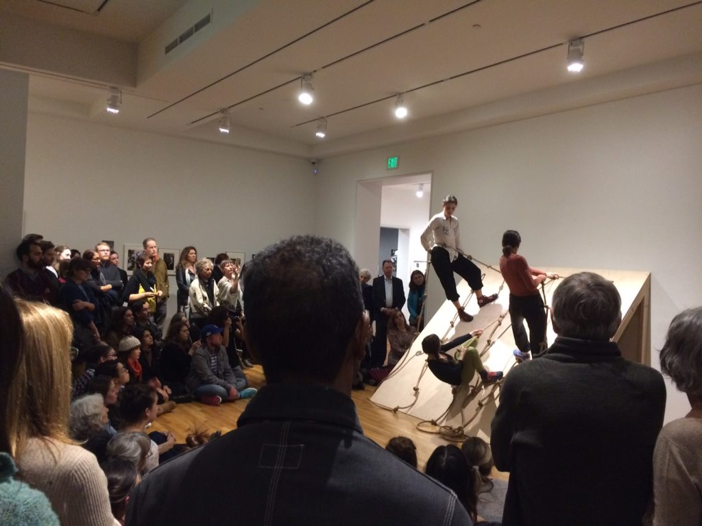 Students in Forti's Slant Board, at the opening of Radical Bodies exhibit, photo by WP